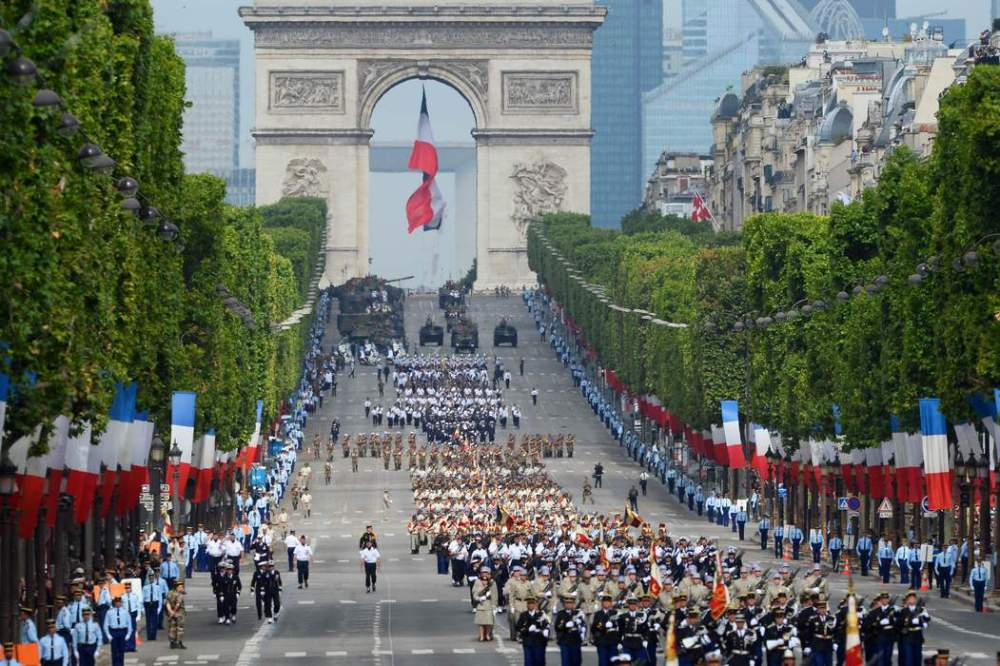 Troops march down the Champs-Elysees avenue during the annual Bastille Day military in Paris, on July 14, 2014.  AFP PHOTO / ALAIN JOCARD